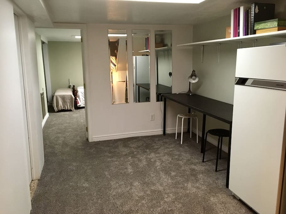 This is a private desk and fridge. The laundry machines that are in the basement are the only part that is shared.