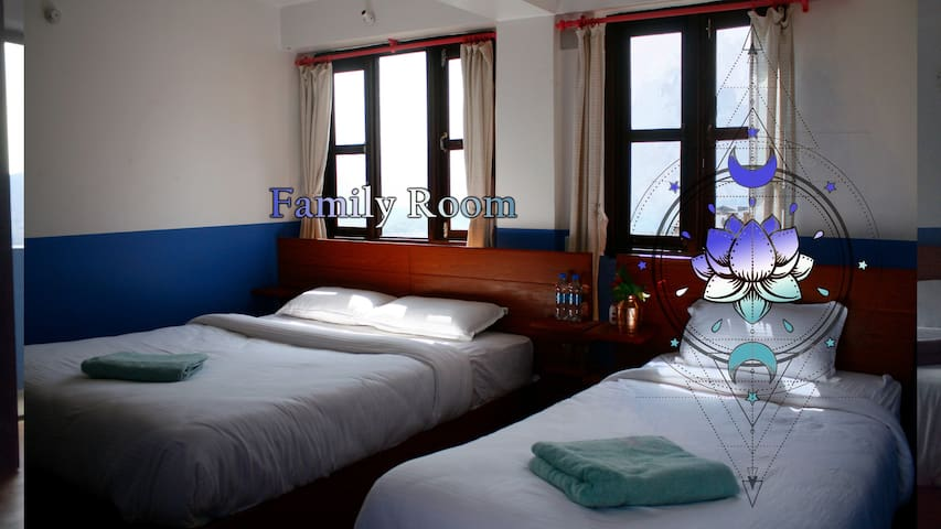 Family Shiny Room in minimatistic Nepali hotel