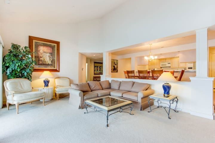 Chic lakefront home with shared pool plus calming views, large balcony