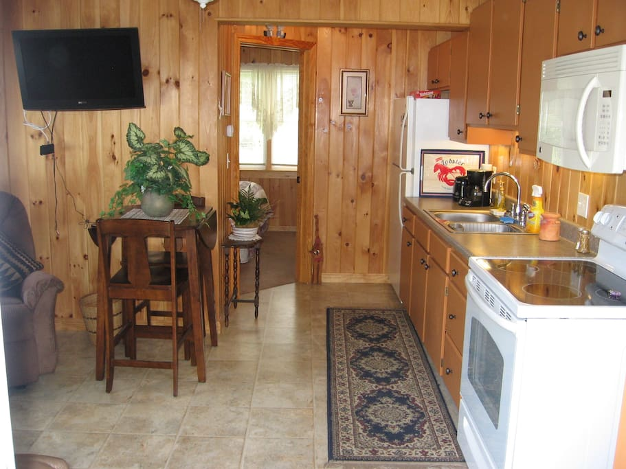 kitchen/dining area, full fridge, stove and microwave, toaster, coffeemaker, blender, crockpot