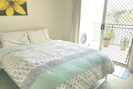 Airy room with private balcony in great location