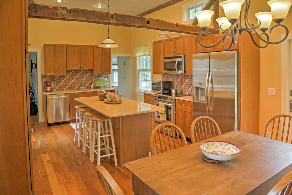 Hardwood floors meet your feet in the kitchen and living area.
