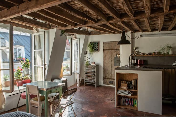 Feel the history: Architect nest between rooftops