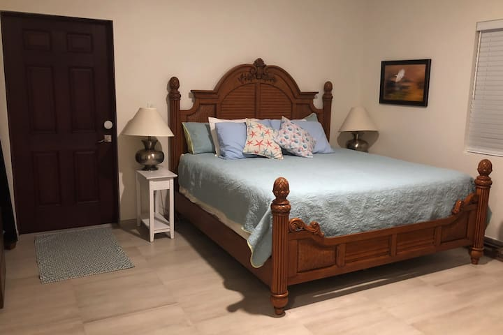 Sleep well in our tropical king-sized bed with memory foam mattress.
