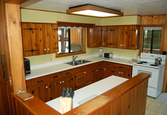 Kitchen (full size refrigerator with freezer, electric stove with oven, microwave, toaster, regular coffee maker). The kitchen is fully equipped with dishes, glasses, pots, pans, knives, etc.