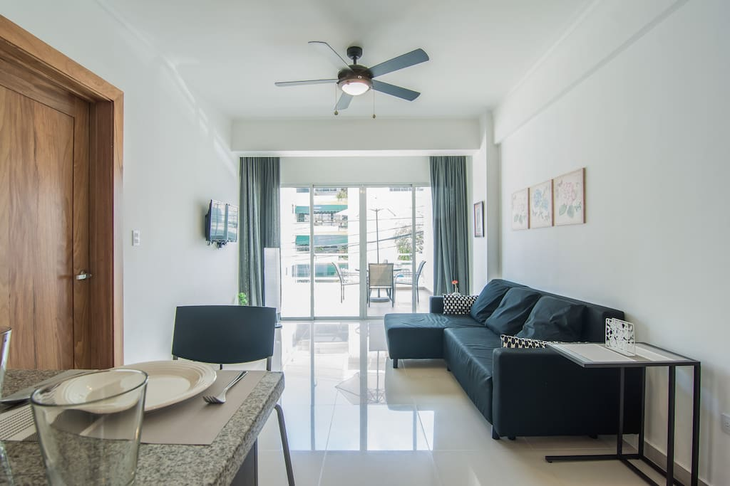 The Livingroom comes with an Open Fully Equipped Kitchen, Sofabed, TV + Cable, WIFI, Spacious Terrace with Seating Area and streetview