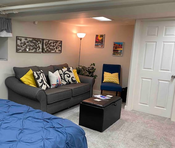 "Enjoy coffee on the pull out sofa bed before a busy day in the city. Ottoman top flips over to be a coffee table, toys stored inside  Please note our ceiling height. Very tall (over 6'3"") people may not be comfortable in our space."
