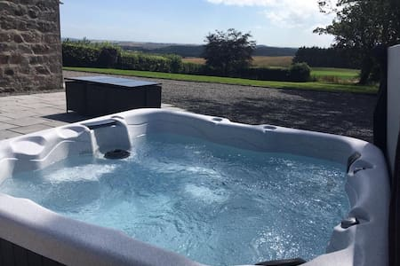 Newton House with hot tub and access to a pool.