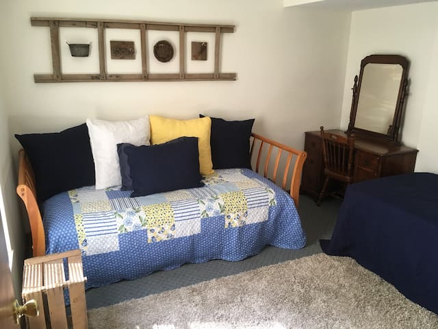2nd Bedroom has 2 twins (one is a daybed), both with soft, breathable 100% cotton sheets. Also has a desk/vanity. Lots of light and a nice view of the woods!