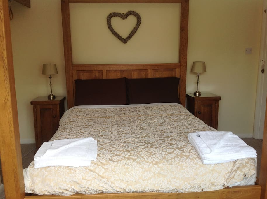 Bespoke solid oak four poster bed with matching furniture