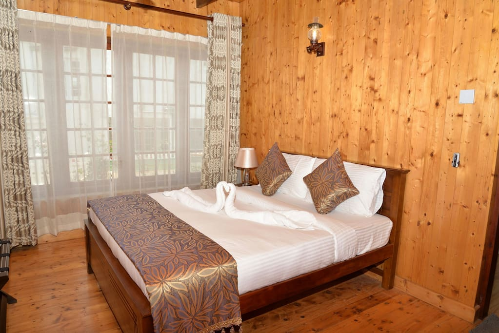 Ginger Bed room is in ground floor with queen bed attached Bath room