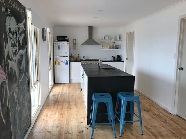 Kitchen has dishwasher and sea views when washing the dishes or sitting at the bar stools.