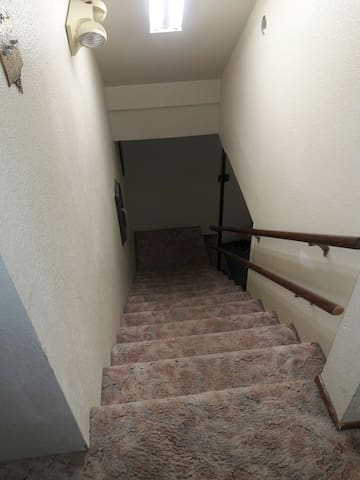 Two flights of stairs (no elevator).