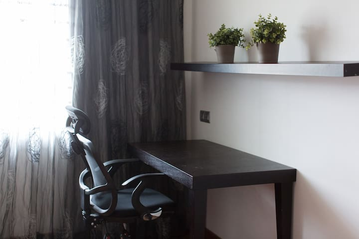Upstairs Master Bedroom: Should you wish to work, you have a desk with power points handy.