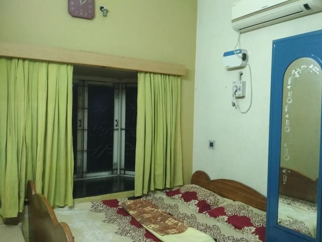 Queen bed ! Air conditioner!  Attached bathroom