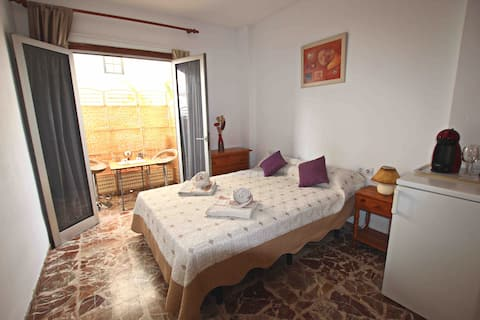 Cozy bedroom, beachside Los Cristianos harbour.