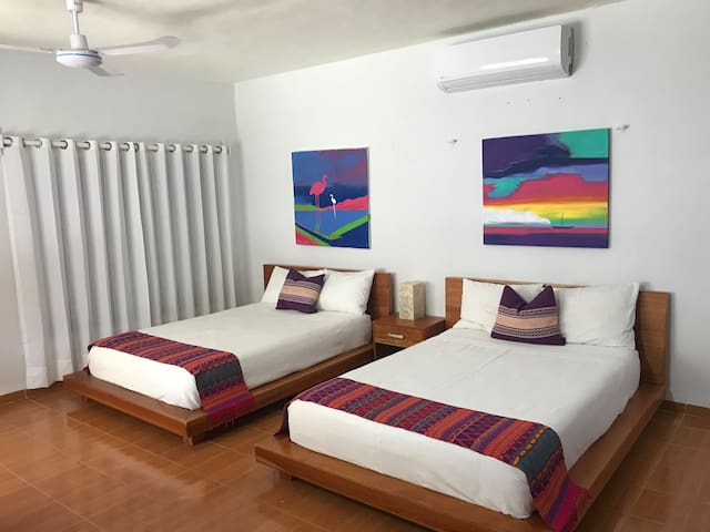 2 comfortable double beds in a bright spacious suite.