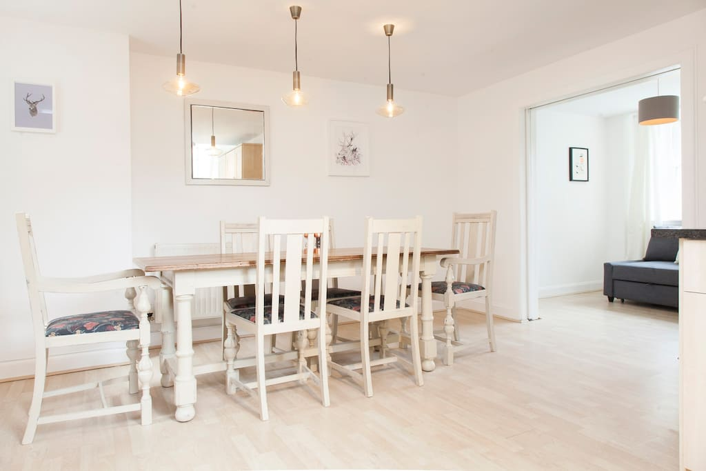 Lovely big dining table and feature lighting