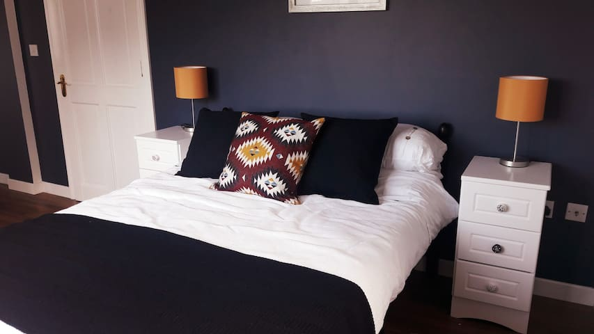 The newly refurbished bedroom  makes for a calming, cosy and relaxing space.