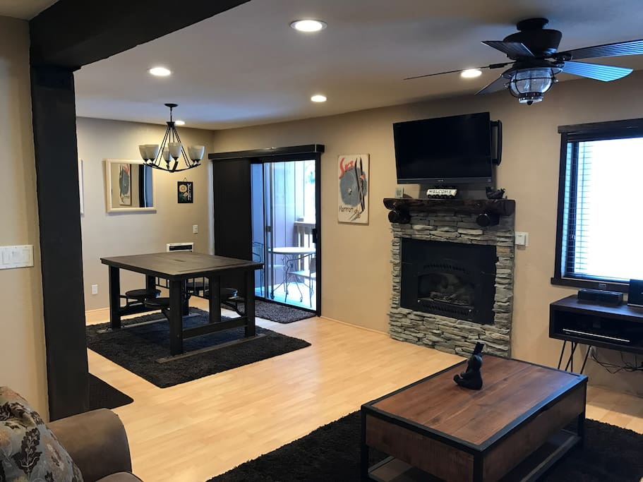 "Rocked gas fireplace, two comfy couches one which is a queen sofa sleeper, 42"" LED , cable TV, DVD, fast high speed Internet, free wifi calling and more!"