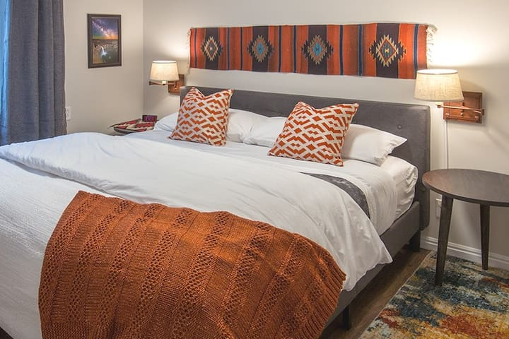 A king bed!!! This bedroom pays tribute to Utah's Native Americans with an original hand-woven Navajo rug. The art on the wall is all done by Utah artists and features local landscapes! Enjoy all the beauty and culture Utah it has to offer!