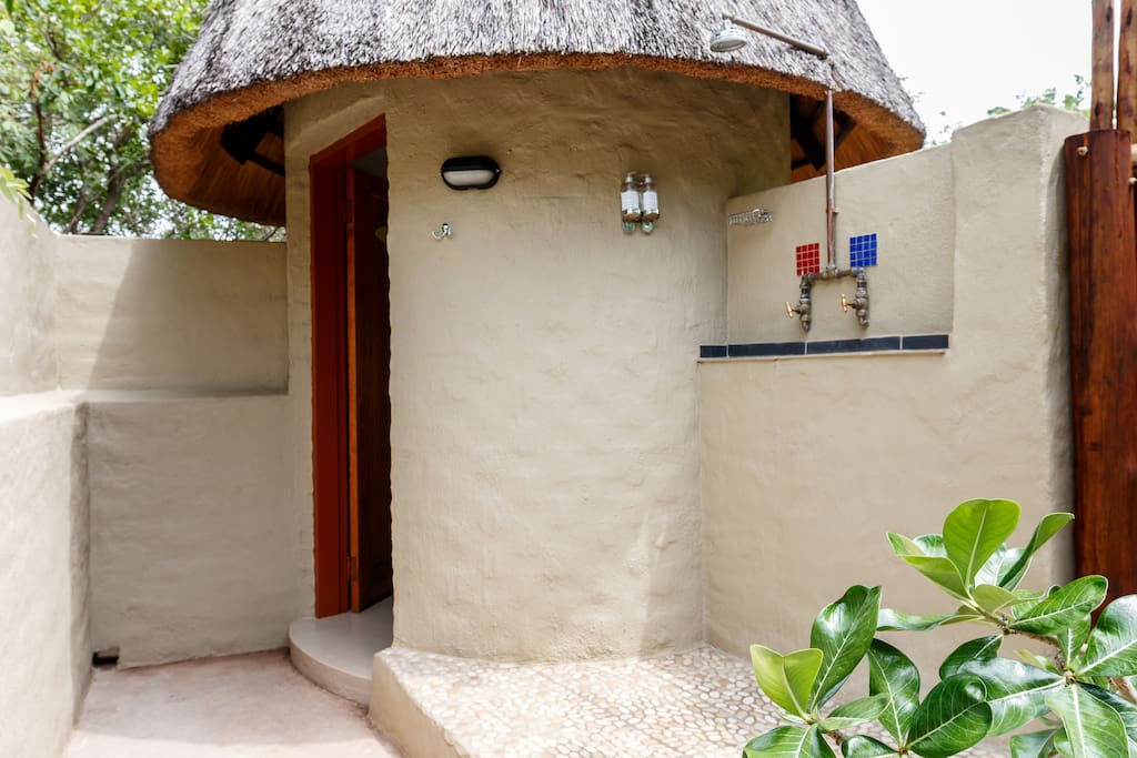 Outdoor Shower in Private courtyard. Toilet and basin in little rondavel.