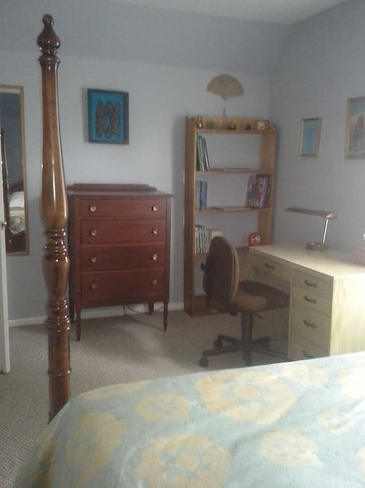 Room has small dresser and desk at your disposal.