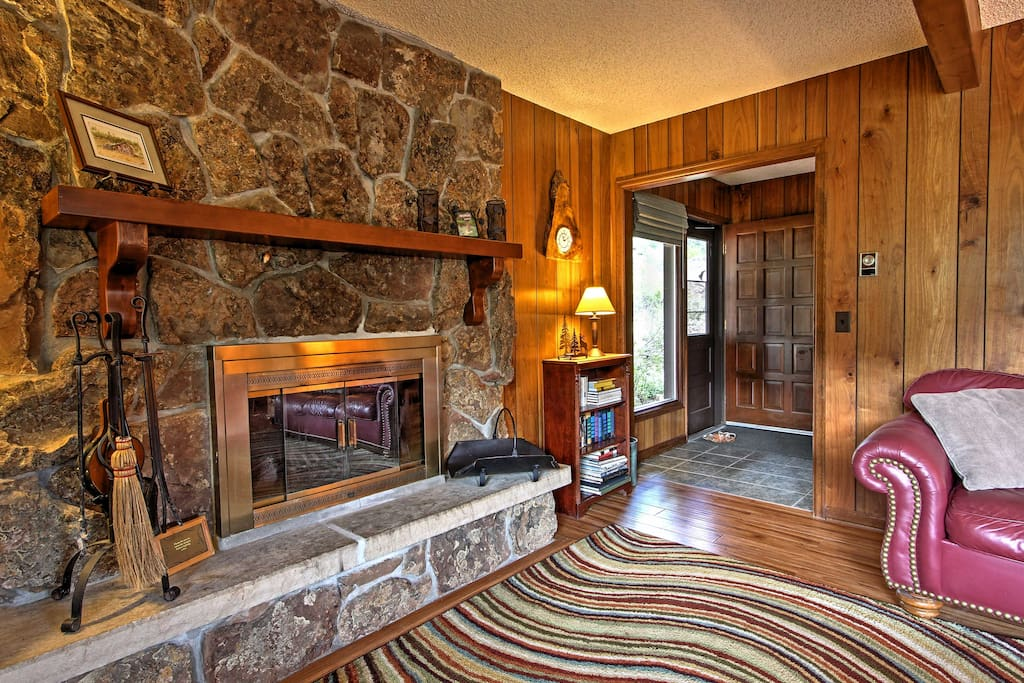 Cuddle close to the moss rock wood-burning fireplace in the living area.