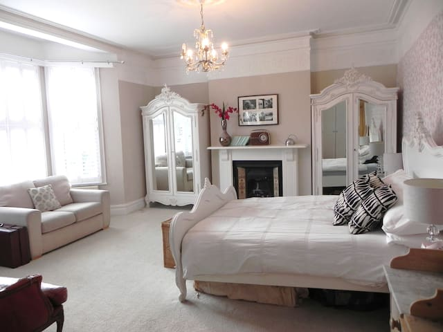 Hard to leave this bedroom which has an en suite and beautiful French shabby chic furniture throughout with an ornately carved bed and two beautiful armoires.