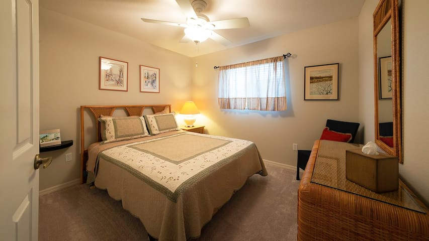 The second bedroom, furnished with queen bed, mirrored dresser, and large closet is perfect for family or visitors.