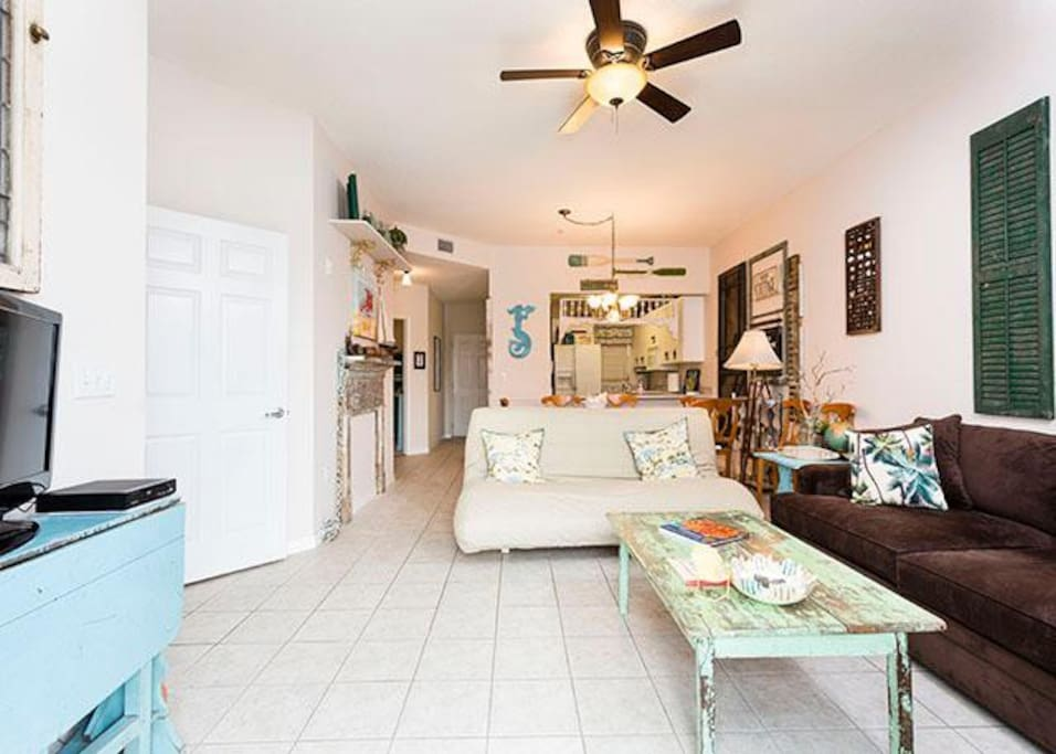 Cool, well furnished, and inviting, our living room awaits! - Stretch out and get comfortable in the airy, well appointed living