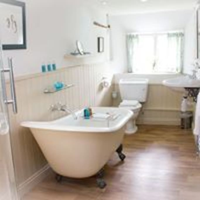 Enjoy long views to Dartmoor from the rolltop bath
