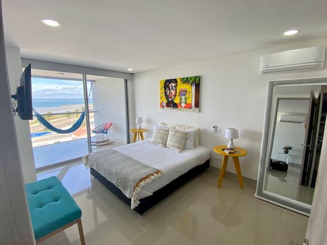 Master bedroom with ocean views. Queen bed. Tv. Has its own bathroom