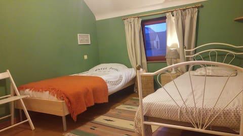 Green bedroom at maisondegaia in Wavre