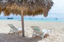 Private beach with private loungers and parasols