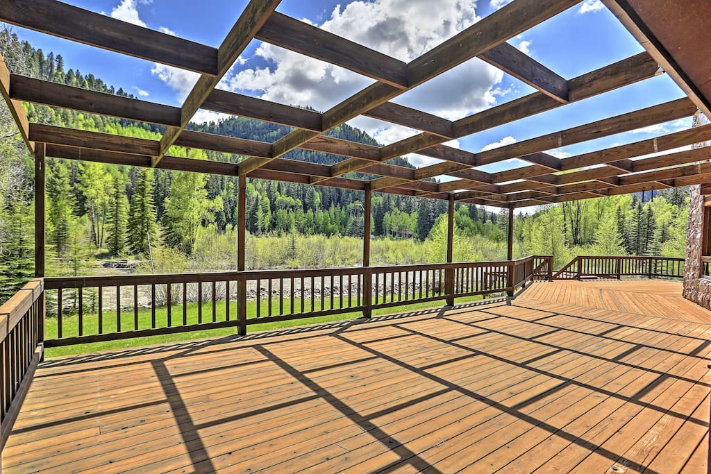 The home features a spacious deck overlooking the Dolores River.
