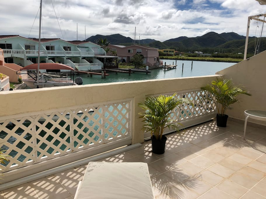 Enjoy waterside views from the patio off the master bedroom