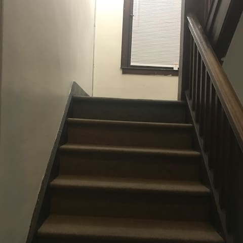 Two bedroom apartment for access to kitchen share a bathroom there is a two bedroom one room can be rented or both shiny brown floors
