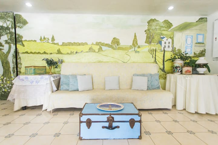 Vintage country style entrance/receiving area with hand painted mural