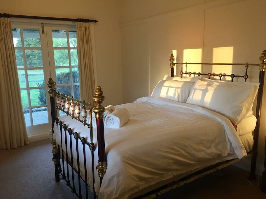 Sunset rays across brass bed: Third Bedroom