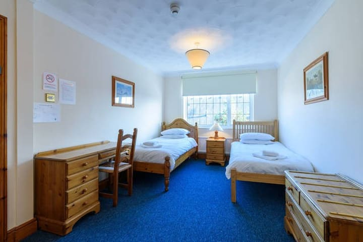 Twin room in lodge set in landscaped gardens