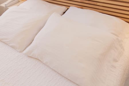 The Studio Queen room has one Queen-sized bed with fresh linens and guest access to a safe.