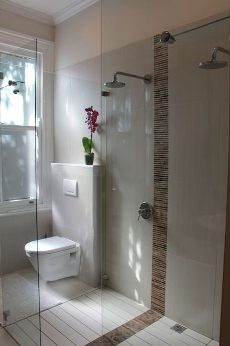 En suite bathroom with double shower and his and hers basins.