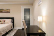 Bedroom #1 desk with elegant desk light and patio door.