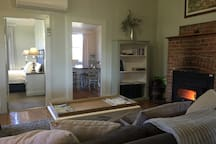 Super comfy Living/lounge area with large screen tv, foxtel, dvd and slow combustion fire
