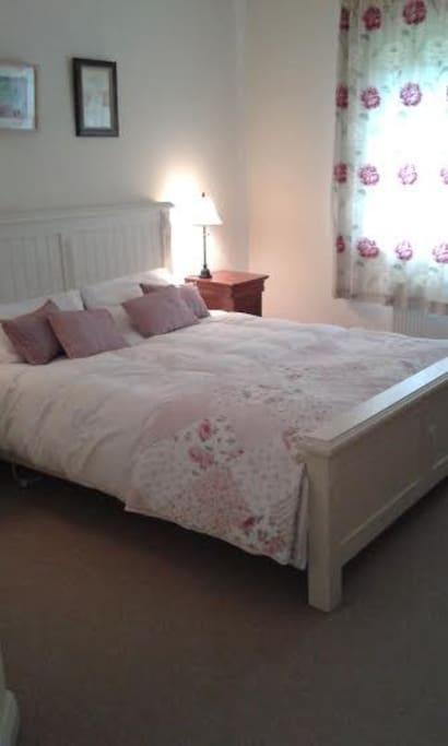 Comfy bed dressed with fresh linen