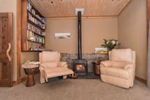 Relax by the fire on comfortable leather lazy boy chairs, while reading a book from our library