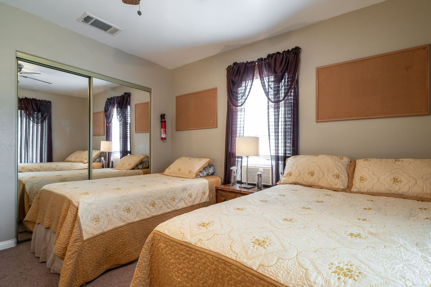 Bedroom 1  - Sleeps 1-3 Twin and Full size REAL beds, Chair, Lamps, Ceiling Fan, Window Air Conditioner, Mirror Closet, Flat Screen TV & DVR