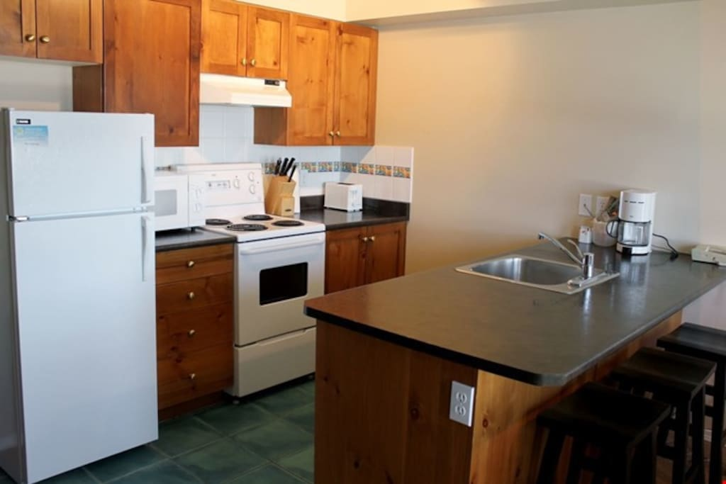 Prepare meals in the fully-equipped kitchen with breakfast bar.