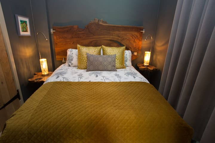 Very comfortable king size bed with unique chestnut headboard from Earl Mountbatten's estate
